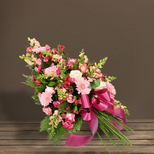 Fleurs deuil Gerbe à main à dominante rose